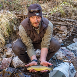 Andy Dean New Mexico Fish and Wildlife Conservation Office holds a Gila trout Mineral Creek photo Craig Springer USFWS resized